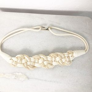 Braided belt with pearl details and a gold closure